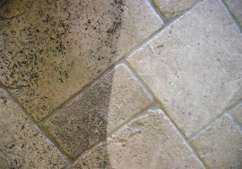 Dirty tile partially cleaned